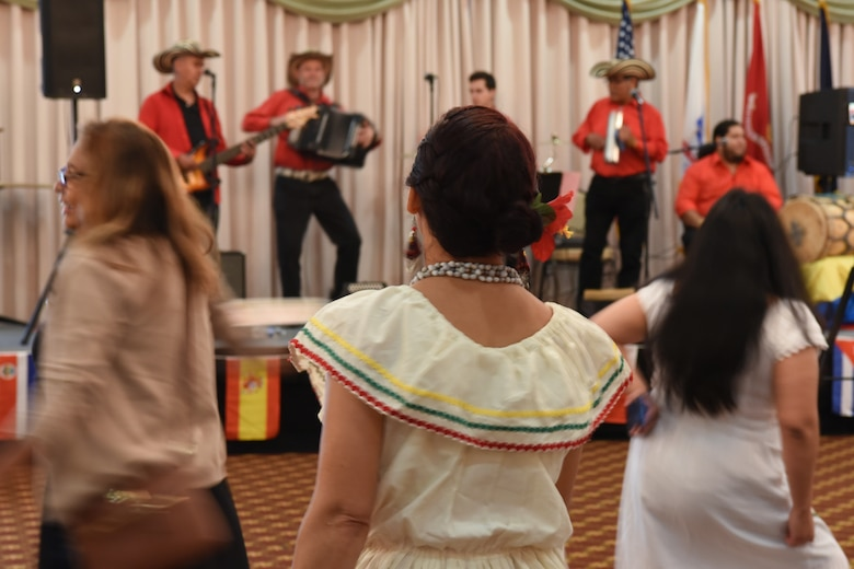 "Hispanic Heritage Committee members and attendees dance to the live performance from the band ""Viva Vallenato Cumbia"" for the Hispanic Heritage Celebration at Joint Base McGuire-Dix-Lakehurst, New Jersey, Oct. 4, 2019. The event showcased all 21 Hispanic countries to educate the joint base community about the heritage month, which is celebrated from September 15th through October 15th every year. (U.S. Air Force photo by 1st Lt Jaclyn Sumayao)"