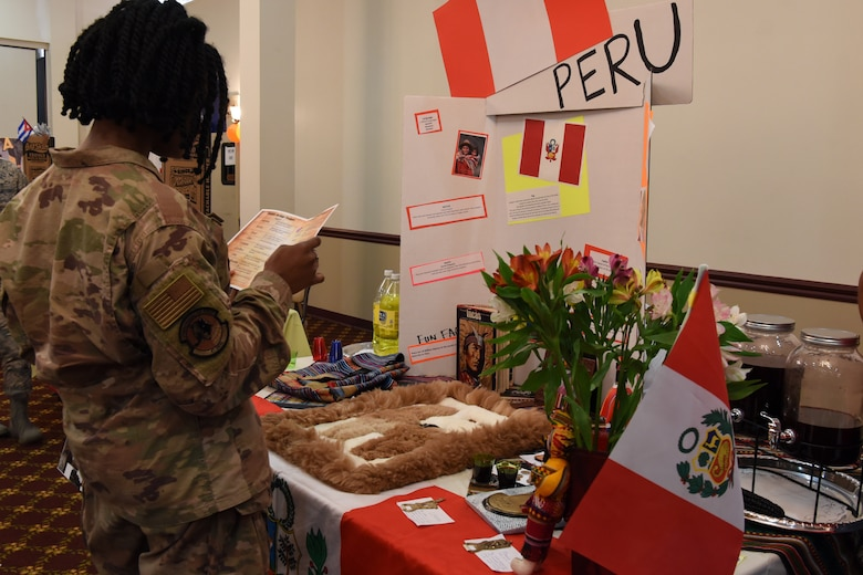 "A military member reads an educational poster board on Peru during the Hispanic Heritage Celebration at Joint Base McGuire-Dix-Lakehurst, New Jersey, Oct. 4, 2019. The Hispanic Heritage Committee focused on educating the joint base through a ""Museum of Countries"" display highlighting all 21 Hispanic countries. (U.S. Air Force photo by 1st Lt Jaclyn Sumayao)"