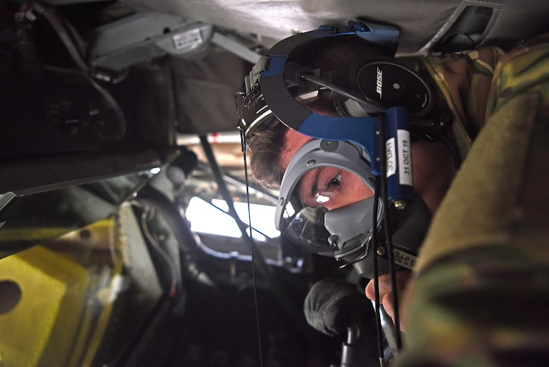 Airman 1st Class Benjamin Blake, 351st Air Refueling Squadron boom operator, checks his oxygen mask prior to takeoff during a readiness exercise at RAF Mildenhall, England, Oct. 3, 2019. Exercise scenarios were designed to ensure 100th Air Refueling Wing Airmen were fully prepared for potential contingencies in the wing's area of responsibility. (U.S. Air Force photo by Airman 1st Class Brandon Esau)