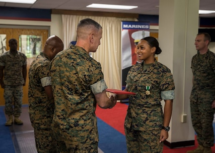 Sergeant Fay D. Stafford, a prior-service recruiter with Prior-Service Recruiting Substation Charlotte, recieves a Navy and Marine Corps Commendation medal as part of the 6th Marine Corps Distrct Offensive at the 6MCD Headquarters aboard Marine Corps Recruit Depot Parris Island, South Carolina on Sept. 23, 2019. All prior-service recruiters that went above and beyond their mission were awarded a Navy and Marine Corps Commendation medal by the 6th District Commanding Officer. (U.S. Marine Corps photo by Cpl. Jack A. E. Rigsby)