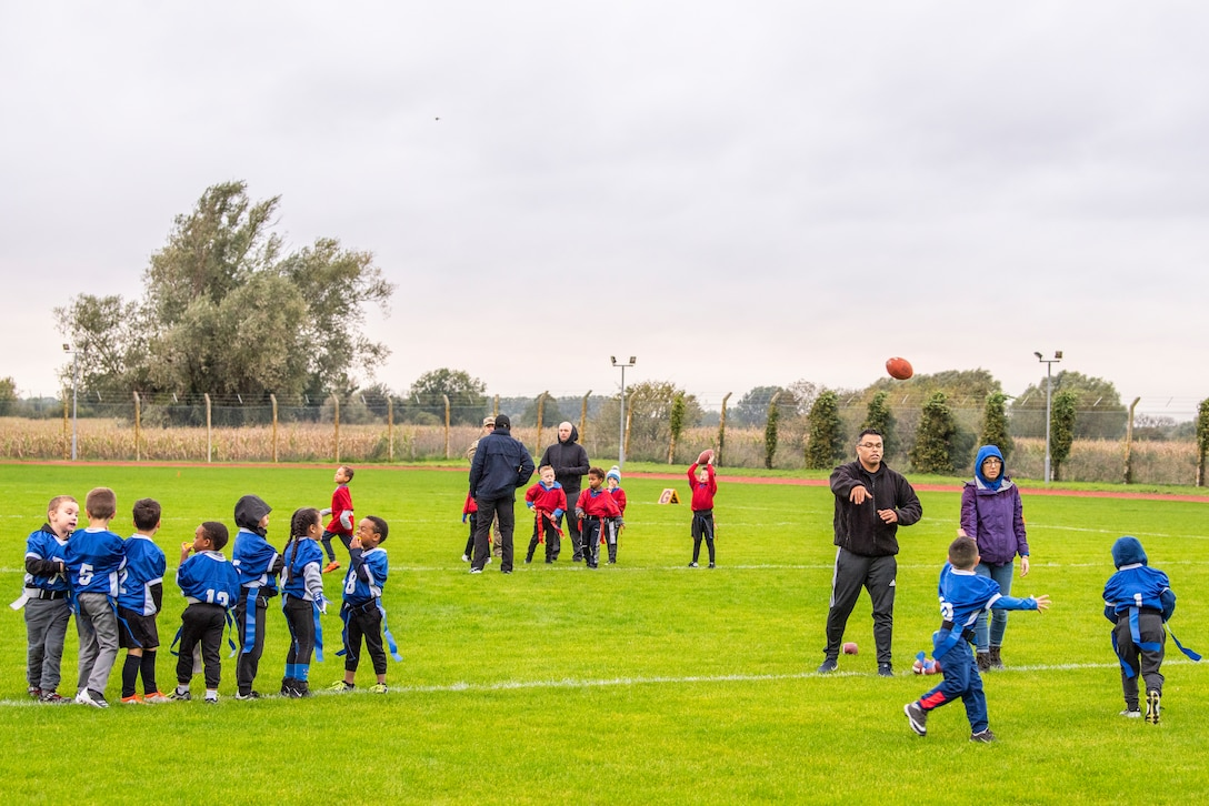 A flag football team warms up for their game at Heritage Park Oct. 7, 2019, at RAF Mildenhall, England. The park reopened following a six-month renovation. (U.S. Air Force photo by Airman 1st Class Joseph Barron)