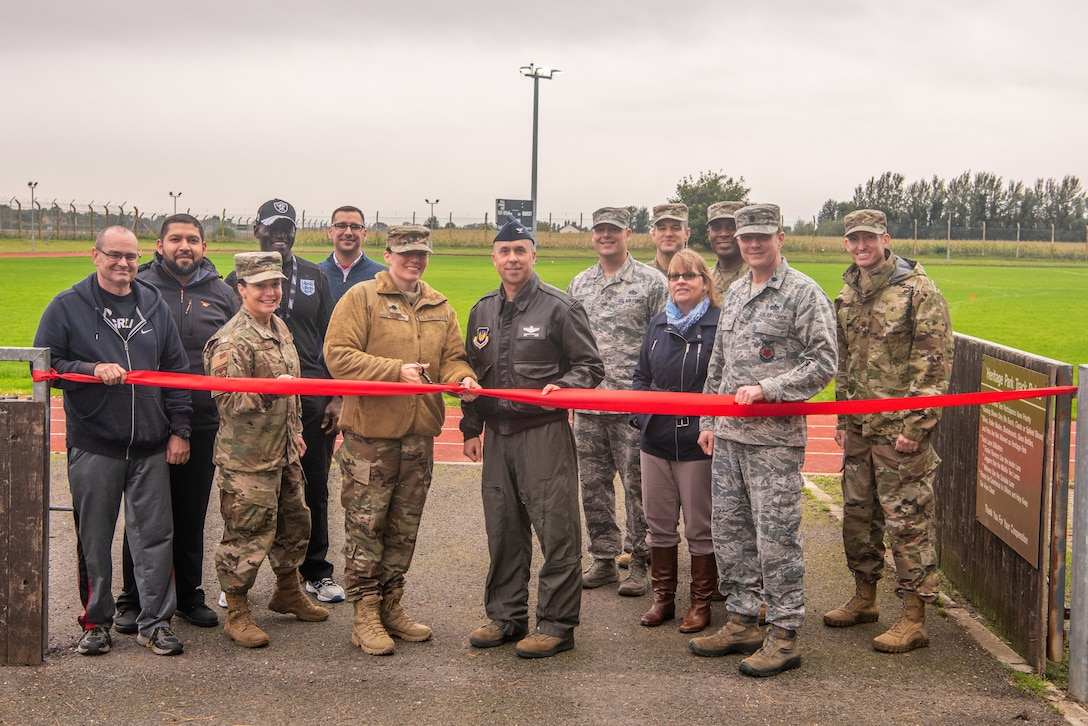 100th Air Refueling Wing leadership cuts a ribbon to mark the reopening of Heritage Park Oct. 7, 2019, at RAF Mildenhall, England. The park reopened following a six-month renovation. (U.S. Air Force photo by Airman 1st Class Joseph Barron)