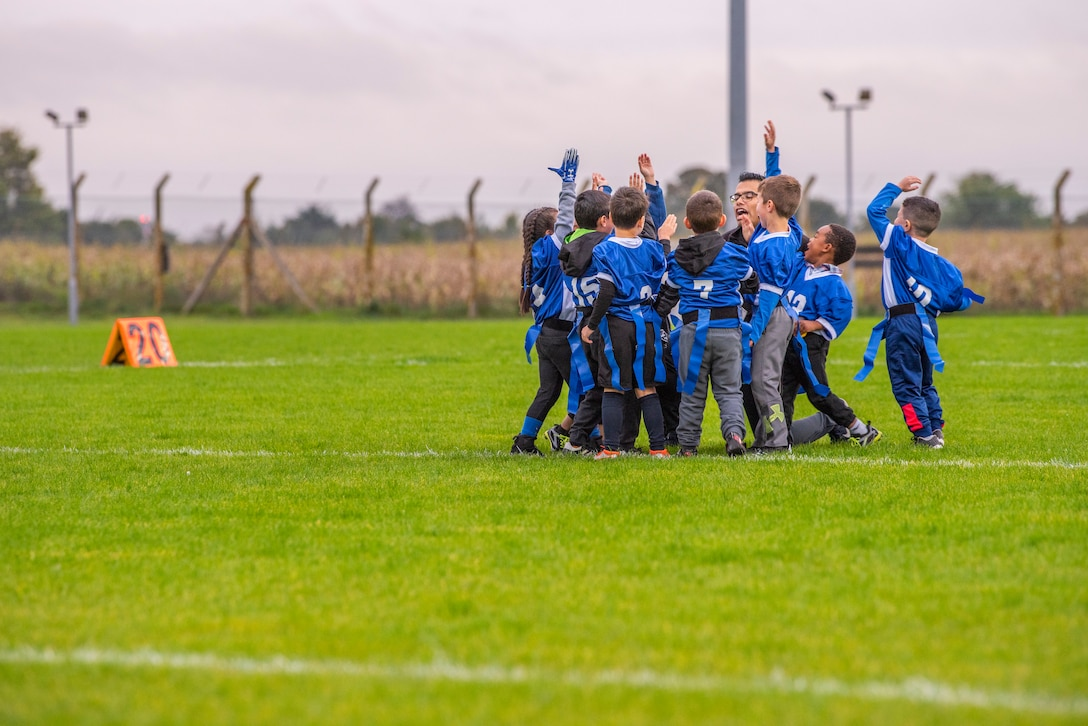 A children's flag football team breaks from the huddle before their game at Heritage Park Oct. 7, 2019, at RAF Mildenhall, England. The park reopened following a six-month renovation. (U.S. Air Force photo by Airman 1st Class Joseph Barron)