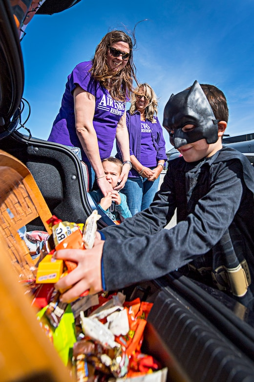 Holy Handfuls Batman! A 'Tanker Treater' scoops up a handful of candy like a boss while making the rounds Oct. 6, 2019 during the family day and fall festival held at Grissom Air Reserve Base, Indiana. Focus on families and resiliency were key points during the two-day event designed to promote camaraderie and esprit de corps. (U.S. Air Force photo/Douglas Hays)