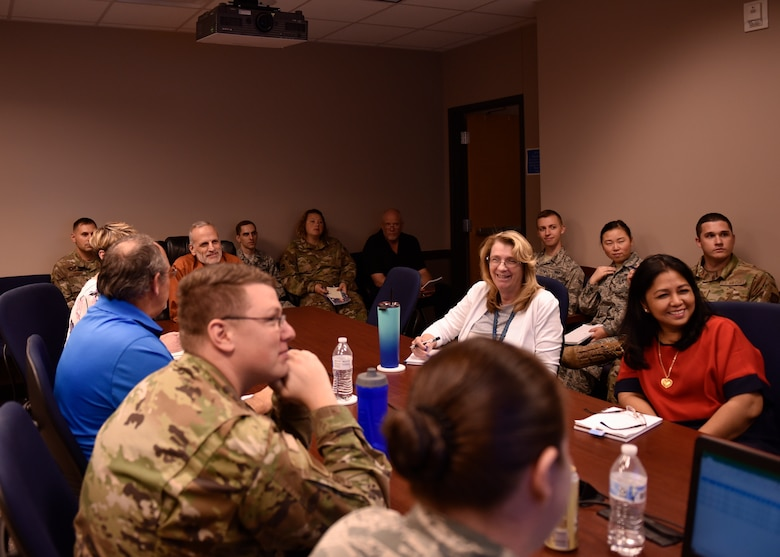 Members of the 21st Comptroller squadron gather to discuss how end of the fiscal year closeout is proceeding Sept. 30, 2019 at Peterson Air Force Base, Colorado. Peterson's Finance Office doesn't just cover the 21st Space Wing, but also all tenant units located on Peterson AFB. (U.S. Air Force photo by Airman Alexis Christian)