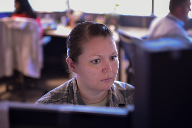 1st Lt. Danielle Sease, 21st Comptroller Squadron flight commander and financial analyst, works at her computer in the finance office Sept. 30, 2019 at Peterson Air Force Base, Colorado. Sept. 30 marked the end of the fiscal year and the end of year closeout for finance. (U.S. Air Force photo by Airman Alexis Christian)