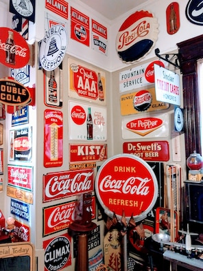 Classic signs advertising various soft drinks are displayed in the home of Jim Raabe, Capital Improvements Branch Systems Safety Program manager at Arnold Air Force Base. (Courtesy photo)