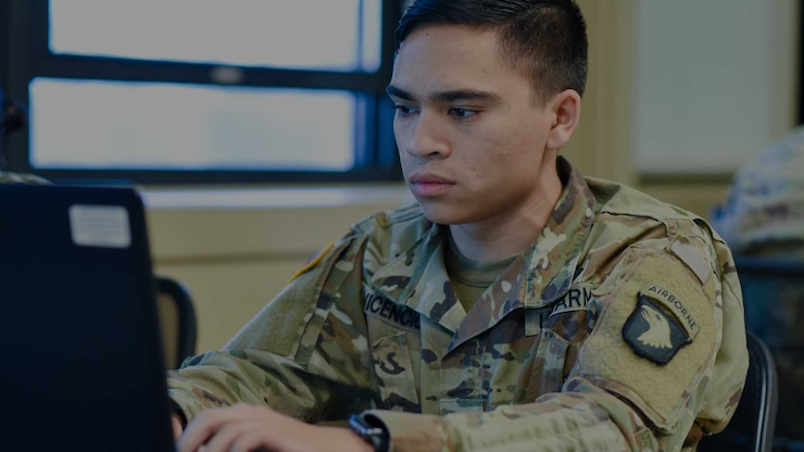 Soldier attending BLC looking at a laptop