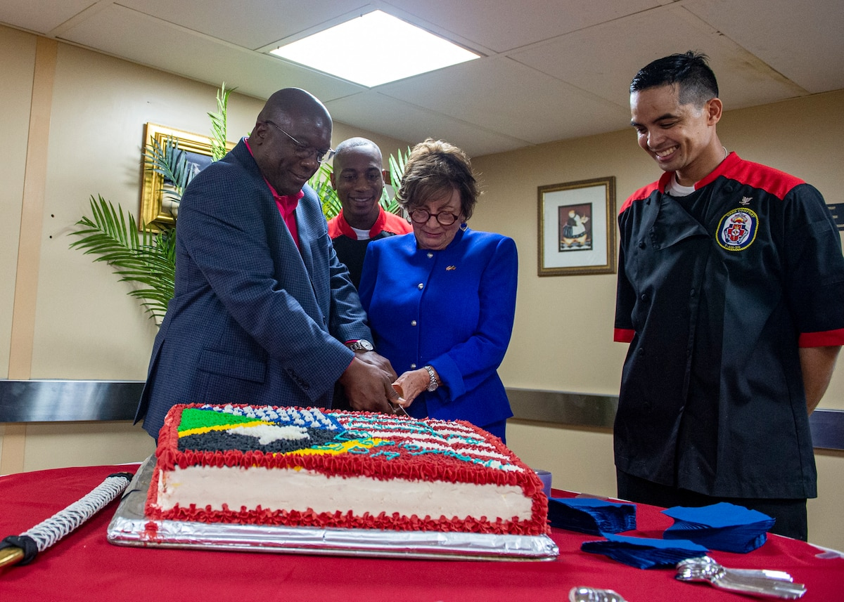 Dr. Timothy Harris, Prime Minister of St. Kitts and Nevis, visits USNS Comfort and Linda Taglialatela, U.S. ambassador to Barbados and the Eastern Caribbean, cut a cake.
