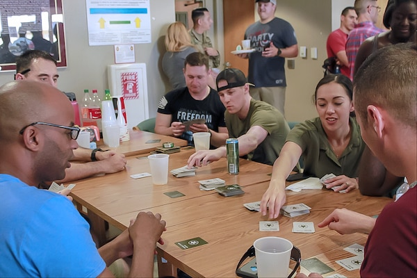 Soldiers at the Warrior Transition Battalion Liberty Barracks at Joint Base San Antonio-Fort Sam Houston enjoy a game of cards.