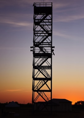 The silhouette of the 90 foot tower stands tall as fire protection professionals prepare to climb its stairs at top speed during Blood, Sweat, and Stairs at the Louis F. Garland Department of Defense Fire Academy on Goodfellow Air Force Base, Texas, Oct. 5, 2019. The stairs gave members of Goodfellow a taste of what first responders endured during 9/11 as they climbed 110 floors. (U.S. Air Force photo by Airman 1st Class Ethan Sherwood/Released)