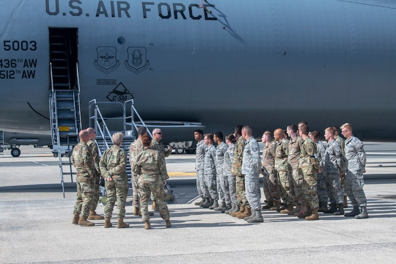 Col. Christopher May, 436th Maintenance Squadron commander, speaks to Airmen assigned to the 436th Aircraft Maintenance Squadron during a dedicated crew chief unveiling ceremony Oct. 4, 2019, at Dover Air Force Base, Del. Prior to this event, May recommended that Major Scholz, 736th Aircraft Maintenace Squadron commander, work with his C-5 sister squadron to submit a combined request to AMC.  (U.S. Air Force photo by Senior Airman Christopher Quail)