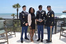 U.S. Army Staff Sgt. Ralph Cajuste is recognized as the Jacksonville Beaches Chamber of Commerce's Soldier of the Year for 2019 at an awards ceremony July 2019. (U.S. Army photo by April Valdez)