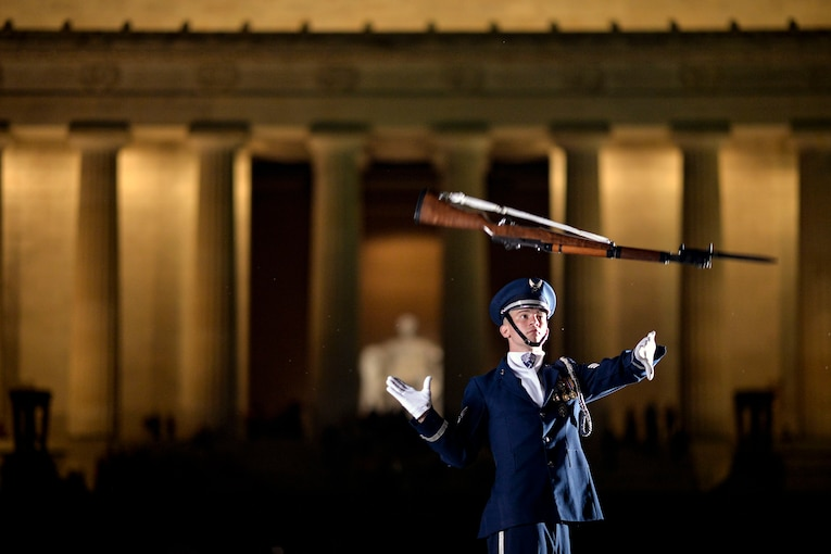 An airman throws a weapon into the air.