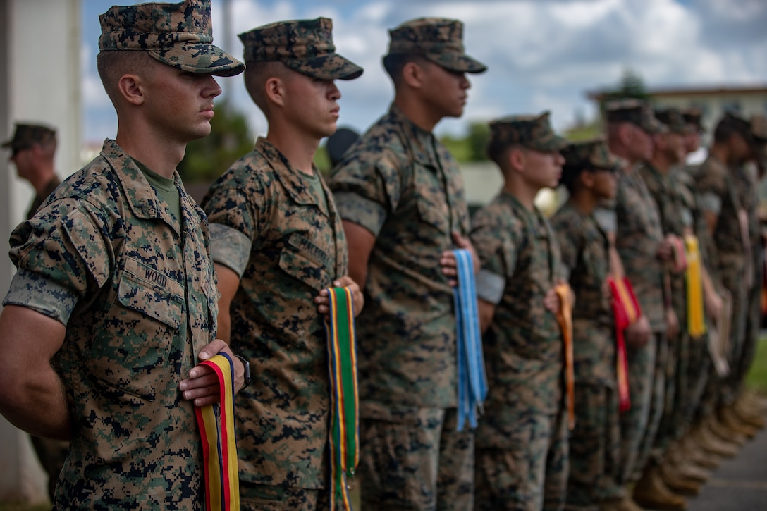 U.S. Marines with 12th Marine Regiment, 3rd Marine Division, participates in the 12th Marine Regiment 92nd Anniversary Battle Colors Rededication Ceremony on Camp Hansen, Okinawa, Japan, Oct. 4, 2019. The ceremony is an opportunity for Marines to remember warriors past and to recognize contributions of service members and families to current operations.