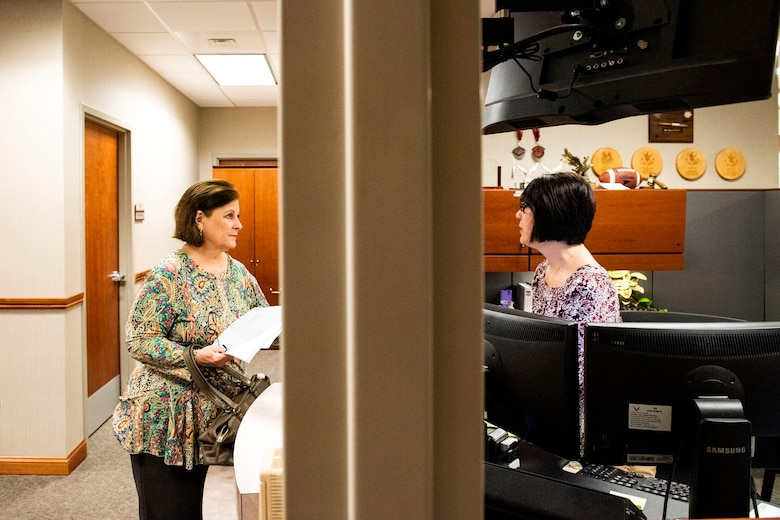 Lisa Pearce, right, 23d Wing paralegal, assists Paula Sheffield, retiree spouse, in completing her will Oct. 8, 2019, at Moody Air Force Base, Ga. The judge advocate office regularly aids retirees and military members with wills on Tuesdays. This free legal assistance provides personal and financial relief for customers and enables Airman readiness. (U.S. Air Force photo by Senior Airman Erick Requadt)