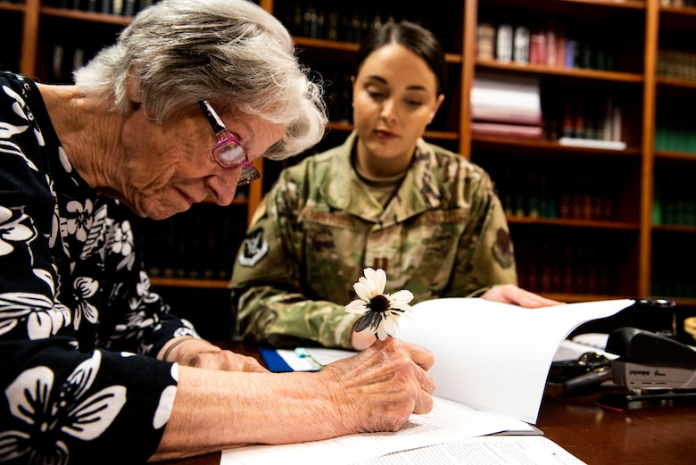 Capt. Katelynn Henderson, right, 23d Wing assistant staff judge advocate (JA), aids Barbara Swindell, retiree spouse, with her will Oct. 8, 2019, at Moody Air Force Base, Ga. JA regularly aids retirees and military members with wills on Tuesdays. This free legal assistance provides personal and financial relief for customers and enables Airman readiness. (U.S. Air Force photo by Senior Airman Erick Requadt)
