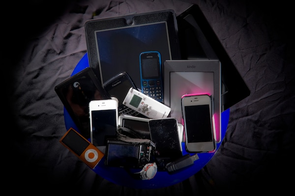 Various personal portable devices including phones and tablets.