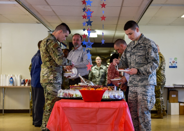 Participants in the Combined Federal Campaign breakfast event get food at Kirtland Air Force Base, N.M., Oct. 7, 2019. The CFC Kirtland AFB fundraising goal for 2019 is $126,000. (U.S. Air Force photo by Airman 1st Class Austin J. Prisbrey)