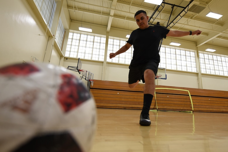 U.S. Air Force Staff Sgt. Edwin Suarez, 921st Contingency Response Squadron air transportation craftsman, goes for a kick during a Club Hub soccer match Oct. 4, 2019, at Travis Air Force Base, California. Club Hub is a program that allows Airmen to organize groups or join other Airmen in activities that interest them. (U.S. Air Force photo by Airman 1st Class Cameron Otte)