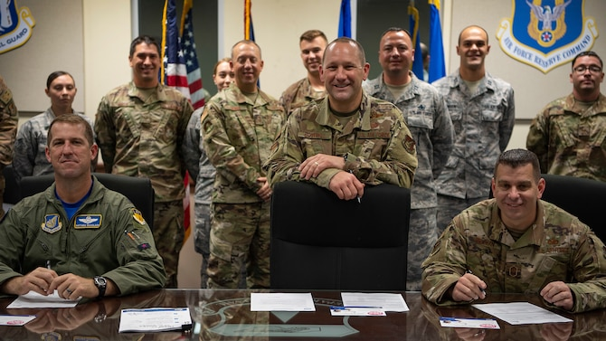 The 36th Wing leadership and the Combined Federal Campaign representatives take a group photo before the CFC kick-off signing, Andersen Air Force Base, Guam, Oct. 4, 2019. The CFC is the official workplace giving campaign of the federal government. (U.S. Air Force photo by Senior Airman Ryan Brooks)