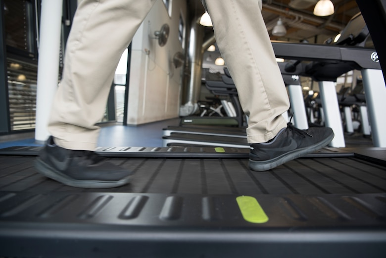 Master Sgt. Joseph McTaggart, non-commissioned officer in charge of Ramstein Air Base Southside Fitness Center walks on one of the new environmentally friendly treadmills at the Southside fitness center on Ramstein Air Base, Germany, Oct. 4, 2019. The treadmill functions entirely on the individuals own energy. As the individual moves, the treadmill transfers the individuals energy into usable energy which is put back into the power grid.