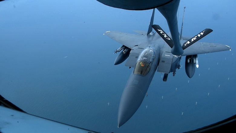 An F-15E Strike Eagle assigned to the 48th Fighter Wing at RAF Lakenheath, England, receives fuel from a 351st Air Refueling Squadron KC-135 Stratotanker during a readiness exercise over England, Oct. 3, 2019. Exercise scenarios were designed to ensure 100th ARW Airmen were fully prepared for potential contingencies in the wing's area of responsibility. (U.S. Air Force photo by Airman 1st Class David Busby)