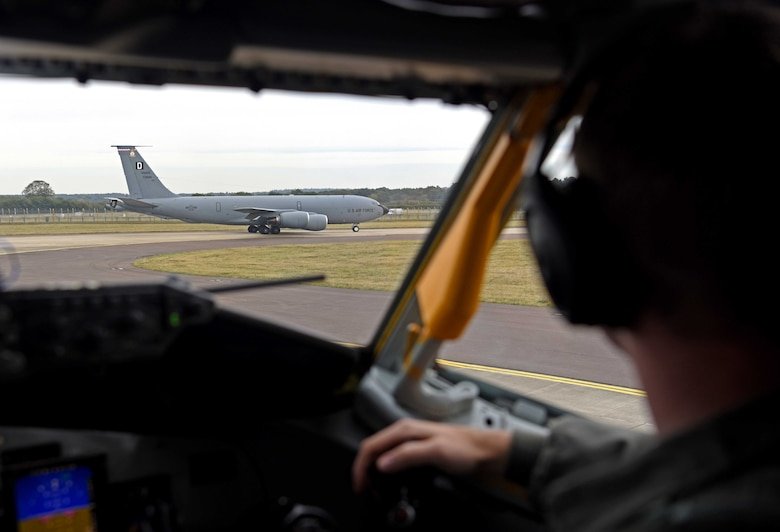 1st Lt. James Winegardner, 351st Air Refueling Squadron pilot, looks on as a KC-135 Stratotanker assigned to the 100th Air Refueling Wing begins to taxi during a readiness exercise at RAF Mildenhall, England, Oct. 3, 2019. Exercise scenarios were designed to ensure 100th ARW Airmen were fully prepared for potential contingencies in the wing's area of responsibility. (U.S. Air Force photo by Airman 1st Class Brandon Esau)