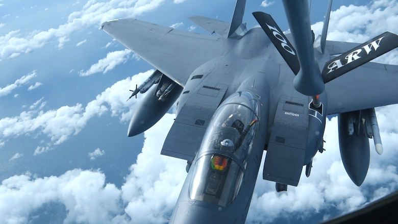 An F-15E Strike Eagle assigned to the 48th Fighter Wing at RAF Lakenheath, England, receives fuel from a KC-135 Stratotanker assigned to the 100th Air Refueling Wing during a readiness exercise over England, Oct. 3, 2019. Exercise scenarios were designed to ensure 100th ARW Airmen were fully prepared for potential contingencies in the wing's area of responsibility. (U.S. Air Force photo by Airman 1st Class David Busby)