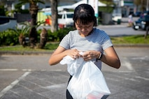 A member of the local community gathers trash during the monthly Friendship Cleanup in Uruma City, Okinawa, Japan on Oct. 5, 2019.