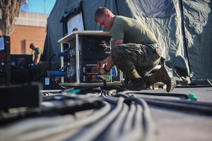 A U.S. Marine with Special Purpose Marine Air-Ground Task Force - Crisis Response - Africa 20.1, Marine Forces Europe and Africa, disassembles a forward resuscitative surgical system at Naval Air Station Sigonella, Italy, Oct. 1, 2019.