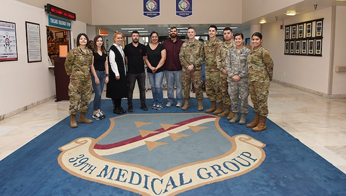 Members of the 39th Medical Support Squadron's Tricare operations and patient administrations flight pose for a group photo Oct. 7, 2019, at Incirlik Air Base, Turkey. The TOPA flight created a new patient travel request form process which contributed to saving the wing approximately $34,000 and 1,300 man-hours annually. (U.S. Air Force photo by Joshua Joseph Magbanua)