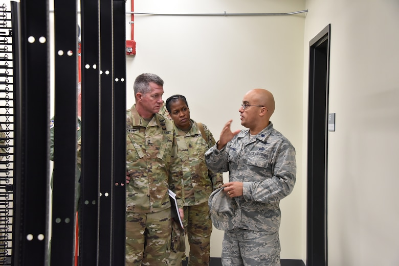 U.S. Air Force Lt. Col. Joed Carbonell, 175th Cyberspace Operations Group deputy commander, gives U.S. Army Maj. Gen. Timothy E. Gowen, adjutant general for Maryland, a tour of the new cyber building Oct. 6, 2019 during his initial visit to the Maryland Air National Guard's 175th Wing in Middle River, Md.