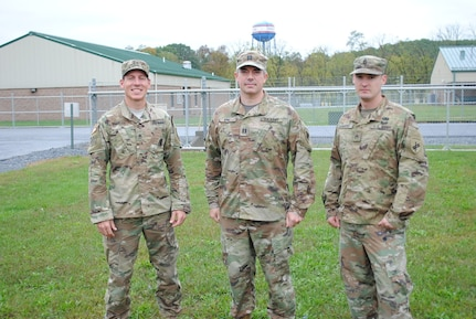 From left to right, Staff Sgt. Michael Bradley, Capt. John King and Staff Sgt. Jonathan Harper pose for a photo outside a warfighter exercise at Fort Indiantown Gap, Pennsylvania. The trio rushed to the aid of fellow citizens after a three vehicle crash on Interstate 81, Sept. 30.