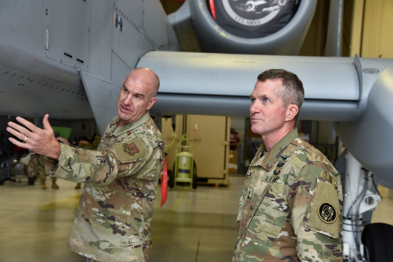 U.S. Air Force Brig. Gen. Edward Jones, Maryland's assistant adjutant general for Air, gives U.S. Army Maj. Gen. Timothy E. Gowen, adjutant general for Maryland, a tour of an A-10C Thunderbolt II aircraft hangar Oct. 6, 2019 during his initial visit to the Maryland Air National Guard's 175th Wing in Middle River, Md.