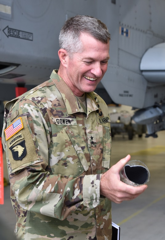 U.S. Army Maj. Gen. Timothy E. Gowen, adjutant general for Maryland, receives a gift from senior leaders from the 175th Wing, Maryland Air National Guard Oct. 6, 2019 during his initial visit to the base in Middle River, Md.