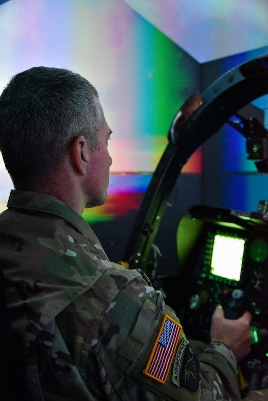 U.S. Army Maj. Gen. Timothy E. Gowen, adjutant general for Maryland, operates an A-10C Thunderbolt II simulator Oct. 6, 2019 during his initial visit to the Maryland Air National Guard's 175th Wing in Middle River, Md.