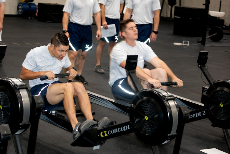 U.S. Air Force Tech. Sgt. Criss Draft, left, and Senior Airman Zachary Stringer, 20th Civil Engineer Squadron, Explosive Ordnance Disposal (EOD) flight technicians, row 1,000 meters during the beta test of the EOD Tier 2 practice fitness test at Shaw Air Force Base, South Carolina, Oct. 4, 2019.