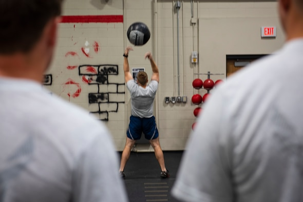 U.S. Air Force Senior Master Sgt. Andrew Filcher, 20th Civil Engineer Squadron, Explosive Ordnance Disposal (EOD) flight superintendent, throws a 20-pound medicine ball in the air at Shaw Air Force Base, South Carolina, Oct. 4, 2019.