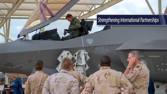 Group of Netherlands' military leaders look on as an F-35 pilot gets out of the cockpit.