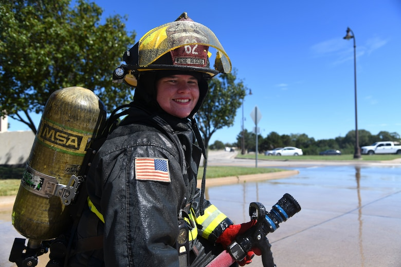 Airman 1st Class Taylor N. Thompson, 22nd Civil Engineering Squadron fire apprentice smiles after performing outdoor training Sept. 23, 2019, at McConnell Air Force Base, Kan. Thompson is the first female firefighter to be stationed at McConnell in the past 20 years. (U.S. Air Force photo by Airman 1st Class Nilsa E. Garcia)