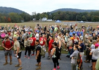 Participants gather at the start of the eighth annual March for the Fallen event Sept. 28, 2019 on Strickler Field at Fort Indantown Gap, Pa. Many participants took time to observe the Wall of Remembrance, which depicts 47 fallen Pennsylvania service members. (U.S. Army National Guard photo by Sgt. 1st Class HollyAnn Nicom)