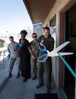 Col. James Price, 432nd Wing/432nd vice commander Air Expeditionary Wing, and SAPR personnel lead a ribbon-cutting ceremony at the new Sexual Assault Prevention and Response Office, at Creech Air Force Base, Nevada, Sept. 30, 2019. All of the same services provided at Nellis - victim advocates, referrals to mental health, counseling, medical care, special victims counsel and more are now available at Creech. (U.S. Air Force photo by Senior Airman Lauren Silverthorne)
