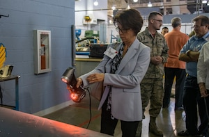 Nancy Meadow-Trigueiro, left, McNaughton Media uses a 3D hand scanner during the 60th Maintenance Group Honorary Commanders tour, Oct. 4th, 2019, at Travis Air Force Base, California.  The purpose of the Honorary Commanders Program is to promote relationships between base senior leadership and civilian partners, foster civic appreciation of the Air Force mission and its Airmen, maximize opportunities to share the Air Force story with new stewards and to communicate mutual interest, challenges and concerns senior leaders and civilian stakeholders have in common. (U.S. Air Force photo by Heide Couch)