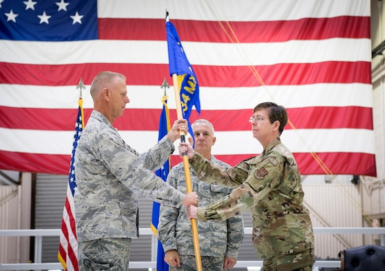 Col. Gretchen Wiltse, 434th Maintenance Group commander, receives the guidon from Col. Larry Shaw, 434th Air Refueling Wing commander, during an assumption of command ceremony at Grissom Air Reserve Base, Indiana Oct. 6, 2019. Wiltse comes to Grissom from Headquarters Air Force Reserve Command, Robins Air Force Base, Georgia, were she served as chief of logistics readiness division. (U.S. Air Force photo/MSgt. Ben Mota)