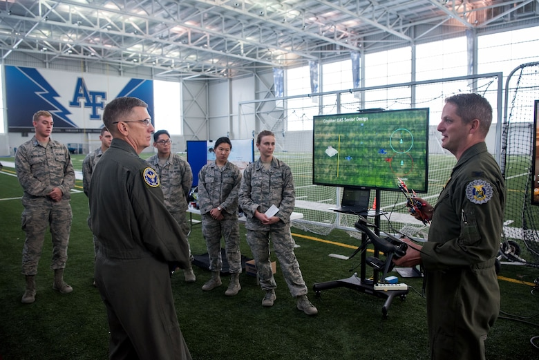 Col. Brian Neff, Head of the Department of Electrical and Computer Engineering, gives Gen. Tim Ray, Air Force Global Strike Command commander, an overview briefing of the Air Force Academy's Unmanned Aerial Systems program Oct. 2, 2019, at the U.S. Air Force Academy, Colo. The UAS research program serves as a platform for cadets across various disciplines to conduct meaningful research supporting the warfighter within the UAS and Unmanned Aerial Vehicles domain. (U.S. Air Force photo by Trevor Cokley)