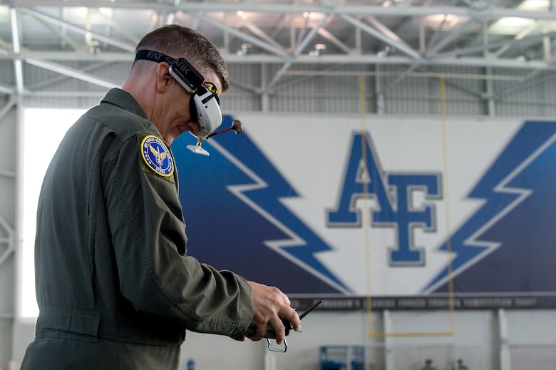 Gen. Tim Ray, Air Force Global Strike Command commander, controls a racing drone during an immersion tour Oct. 2, 2019, at the U.S. Air Force Academy, Colo. As part of Ray's visit to the Academy, he met with cadets and faculty members involved in the Unmanned Aerial Systems research program. (U.S. Air Force photo by Trevor Cokley)