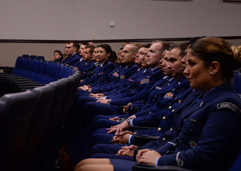Graduates of Specialized Undergraduate Pilot Training Class 19-25 listen to Col. Steven Boatright, 53rd Weapons Evaluations Group commander, during their graduation ceremony Sept. 27, 2019, at Columbus Air Force Base, Miss. Student pilots train for over a year before graduating from SUPT. (U.S. Air Force photo by Airman Davis Donaldson)