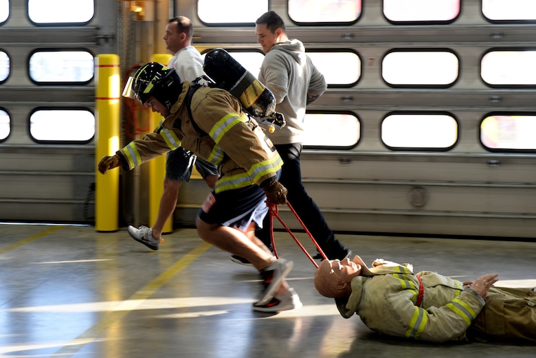An Airman drags a dummy at the 28th Civil Engineer Squadron Fire Department at Ellsworth Air Force Base, S.D., Oct. 4, 2019. The physical exercises Airmen did during the Firefighter Challenge simulate what firefighters do during technical training in preparation for their operational duties at their installations. (U.S. Air Force photo by Airman Quentin K. Marx)