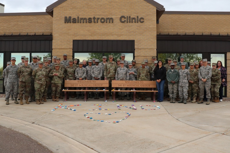 These Airmen were inspired by a local middle school's project and decorated motivational rocks, which are now displayed throughout the building.